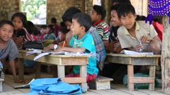 Girls and boys in local school during  lesson. Mrauk U, Myanmar , Burma Stock Footage