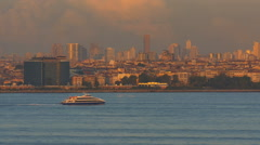 Boat moving past Istanbul Turkey cityscape Sunset-POV - stock footage