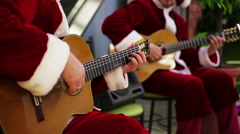 Musicians performing Christmas carol songs to cheer up people before holidays Stock Footage