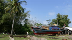 Shipyard with traditional fishing boat in Hoi An Vietnam Stock Footage