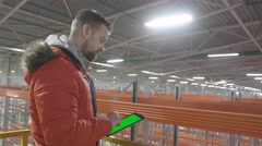 Man in Scissor Lift, presses on the tablet with a green screen and smile at Stock Footage