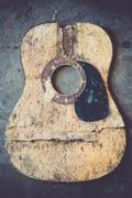 Broken acoustic guitar - stock photo