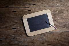 Vintage slate chalk board and pen for slate - stock photo