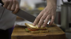Chef preparing sandwich in the restaurant's kitchen. Close up Stock Footage