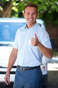 Handyman standing near his delivery van - stock photo