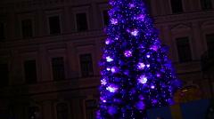 People enjoying Christmas festivities near beautiful New Year tree in big city Stock Footage