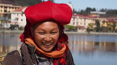 Red Dao Woman Dressed in Traditional Attire, Smiling, in Sapa, Lao Cai, Vietnam - stock footage