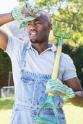 Young man posing with rake Stock Photos