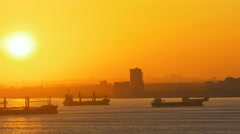 Golden sunset back lights cargo ships heading for Bosporus Straits - stock footage