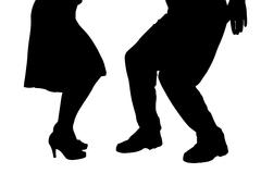 Vector silhouette of a dancing couple. - stock illustration