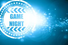 Blue stamp on a glittering background: Game night sign Stock Illustration