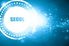 Blue stamp on a glittering background: seoul Stock Illustration