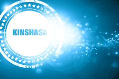 Blue stamp on a glittering background: kinshasa - stock illustration