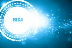 Blue stamp on a glittering background: riga - stock illustration