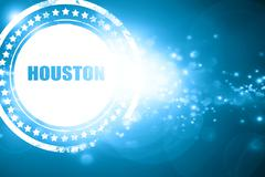 Blue stamp on a glittering background: houston - stock illustration