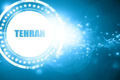 Blue stamp on a glittering background: tehran Stock Illustration