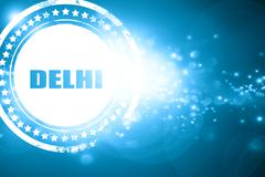 Stock Illustration of Blue stamp on a glittering background: delhi