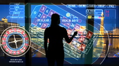 Female live betting in night Las Vegas casino using touchscreen technology - stock footage