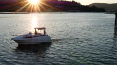 Sailing boat at sea with sun beaming through in Port Moody BC Canada Stock Footage