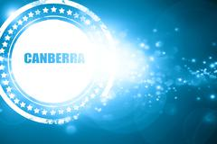 Blue stamp on a glittering background: canberra Stock Illustration