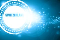 Blue stamp on a glittering background: Greetings from switzerlan Stock Illustration