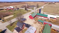 Aerial View of scenic rural community, farms, homes, church,cemetery Stock Footage