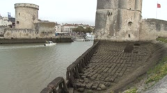 Tilt shot up the harbour towers of La Rochelle in France Stock Footage