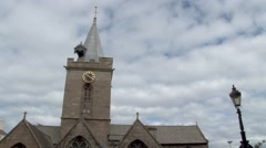 Tilt shot up the spire of Town Church in St Peter Port Stock Footage