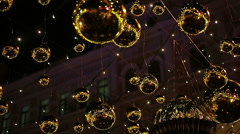 Magic twinkle lights sparkling brightly outdoors, Christmas street decorations Stock Footage