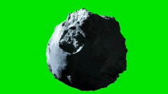 Detailed rotating asteroid or meteor with green screen background - stock footage