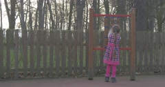 "Little Girl Plays in the ""tic Tac Toe"" Stock Footage"