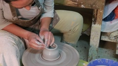 Creative hobby  ceramics artist wearing apron making a pot in a traditional s - stock footage