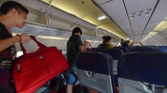 Passengers leave the plane cabin after the flight from Bangkok Stock Footage