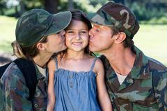 Soldier couple reunited with their daughter - stock photo