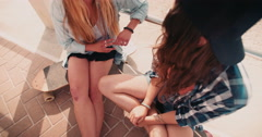 Best girl friends in hipster clothing at the beach front Stock Footage