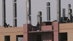 Construction of a brick high-rise building - stock footage
