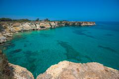 Torre Sant'Andrea, Rocky beach in Puglia, Italy - stock photo