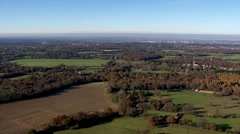 Helicopter shot of countryside looking almost directly down. Small hamlets - stock footage