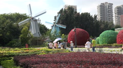 Dutch replica windmills in Chinese theme park in Shenzhen Stock Footage