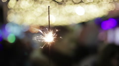 Festive Bengal fire sparkling brightly, creating good mood, New Year celebration Stock Footage