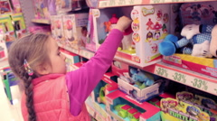 Little girl in toys department store, Model Release - stock footage