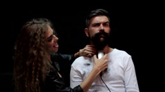 Man entrusted to cut his beard to a girl Stock Footage