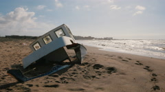 Shipwrecked boat on the beach Stock Footage