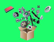 Many spare parts flying out of the box isolated on green screen - stock photo