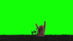 Emerging Zombie Hand shows the Rock and Roll Sign (Green Screen) Stock Footage