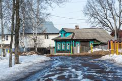 Early spring in the village and the dirt on the road, Russia - stock photo