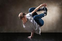 urban hip hop dancer over grunge concrete wall - stock photo