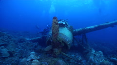 Ocean scenery WWII, slowly circles around propeller, lots of divers, in lagoon, Stock Footage