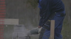 the man works with the Foundation on the construction site 120fps clouse up - stock footage
