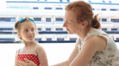 Children girl with mother applying sunscreen Stock Footage